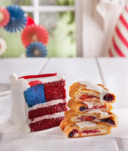 Slice of American flag cake and kringle