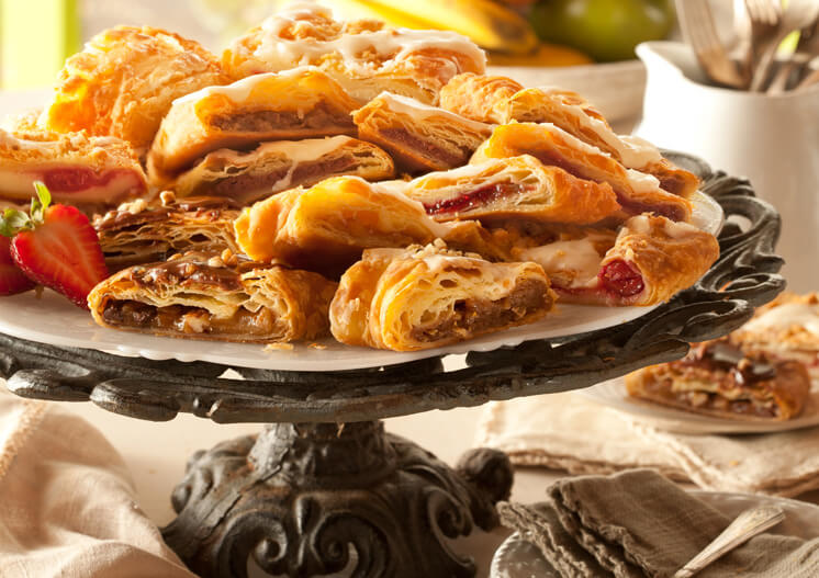 Sliced kringle on cake stand